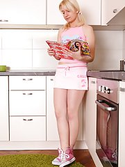 Marusya is standing in her kitchen waiting for her man to arrive home and waits patiently.