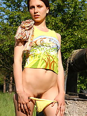 Lustful teeny pets herself in the bush